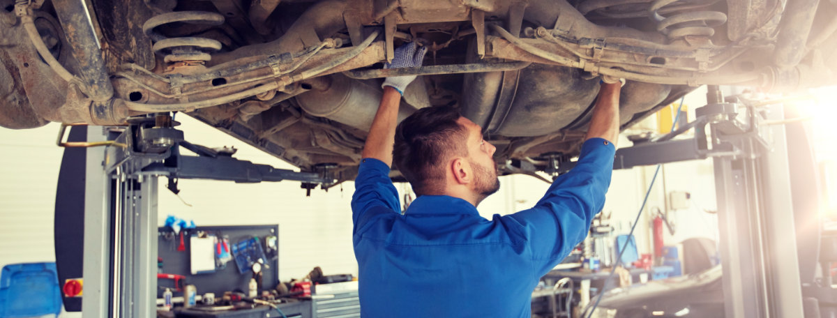 Mechanic servicing a vehicle on a ramp - Car Servicing Thirsk